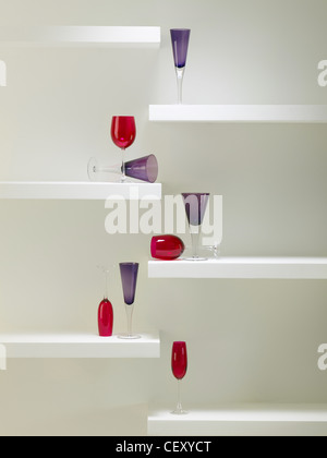 set of purple and red colored/coloured wine glasses - Stock Photo