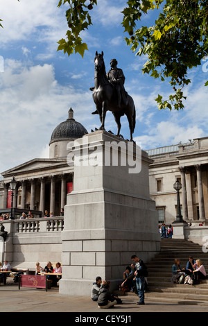 A view of the statue of King George the IV (fourth) at Trafalgar Square - Stock Photo