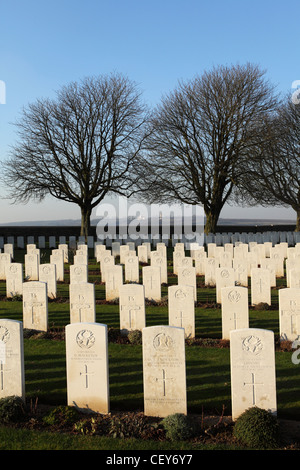 The headstones of First World War soldiers at Cabaret-Rouge British Cemetery at Souchez, France. - Stock Photo