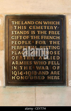 Inscription at the entrance to Cabaret-Rouge British Cemetery at Souchez, France. - Stock Photo