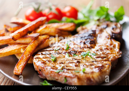 steak and chips with salad - Stock Photo