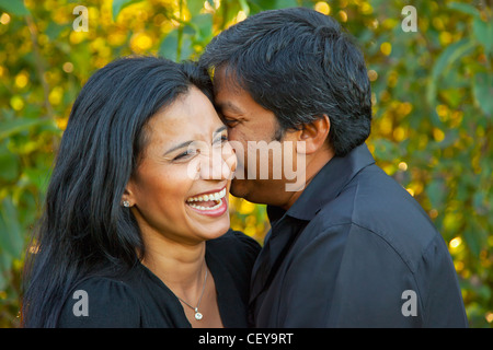 a couple enjoying time together in a park; edmonton alberta canada - Stock Photo