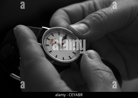 Resetting a watch for daylight saving time or British Summer Time BST by one hour in March and October. - Stock Photo