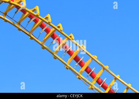 Rollercoaster (against blue sky) - Stock Photo