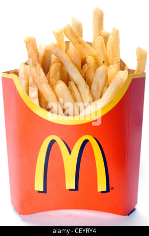 Portion of McDonald's french fries in red cardboard container - Stock Photo
