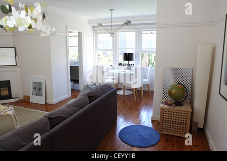 Apartment in Sydney Living room interiwith corner sofa from Habitat, Butterfly pendant chandelier from Ambience - Stock Photo