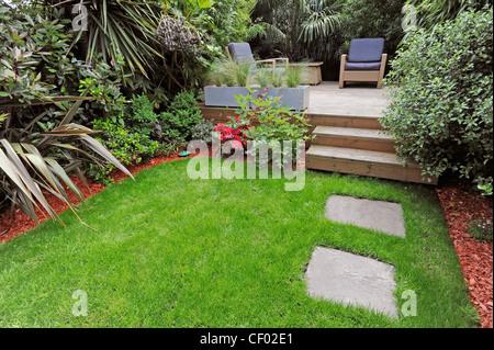 Uk gardens small outdoors garden patio seating area stock for Garden decking north london