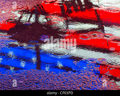 American flag reflection in a puddle - Stock Photo
