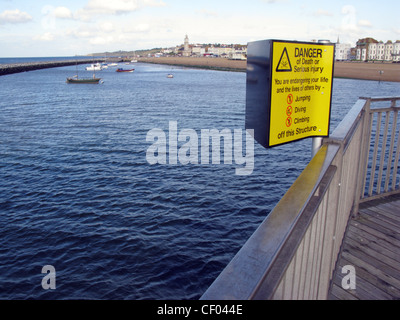 Warning sign on the Pier at Herne Bay, Kent, no jumping, diving, or climbing. - Stock Photo