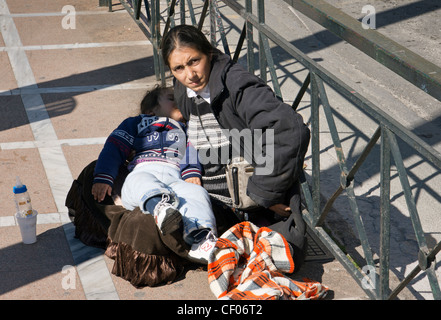 Beggar Woman with baby in Athens Stock Photo