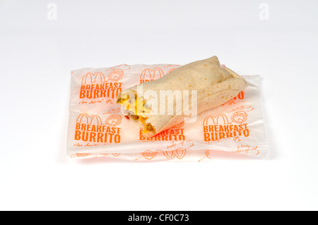 McDonald's sausage breakfast burrito with paper wrapper on white background cut out USA. - Stock Photo