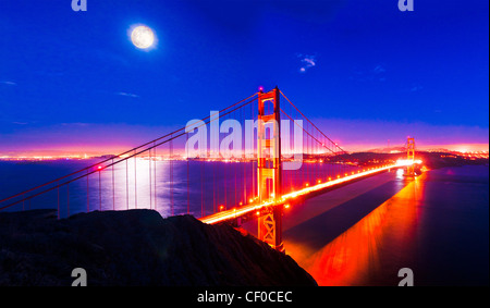 Full moon rising over the Golden Gate Bridge, San Francisco, California, USA - Stock Photo