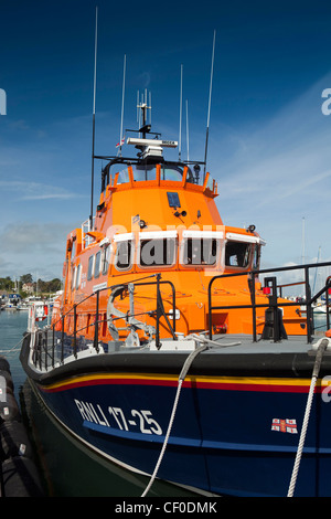 UK, England, Isle of Wight, Yarmouth Harbour, RNLI 17-25 lifeboat moored at the quayside - Stock Photo