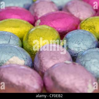 Coloured foil wrapped mini Easter eggs - Stock Photo
