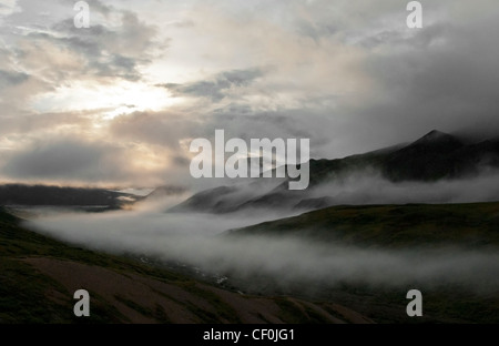 Daybreak over the East Fork River where mist and clouds mingle with mountain and river. Denali National Park, Alaska - Stock Photo
