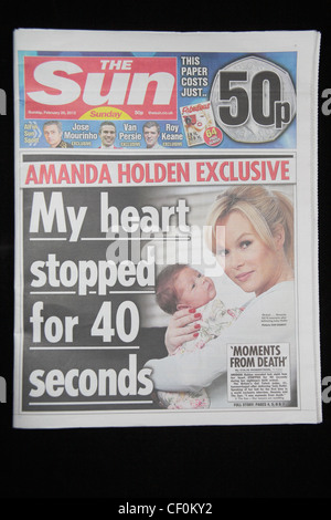 The first copy of 'The Sun on Sunday' tabloid British Sunday newspaper, launched on 26th February 2012. - Stock Photo
