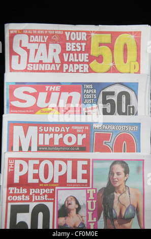 The tabloid red top British national Sunday newspapers:Daily Star Sunday, The Sun on Sunday, Sunday Mirror & The - Stock Photo