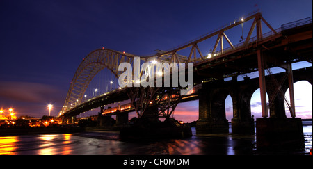 Runcorn Passenger Road Bridge at Night. Dusk image from the Widnes side, south of the Mersey river on its way to - Stock Photo