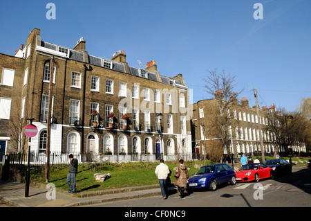 Georgian terraced houses in Duncan Terrace with people Islington London England UK - Stock Photo