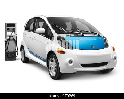 2012 Mitsubishi i MiEV electric car and a charging station isolated on white background with clipping path - Stock Photo