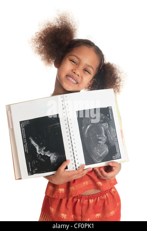 afro american asian black child with book ultrasound isolated metisse long hair - Stock Photo