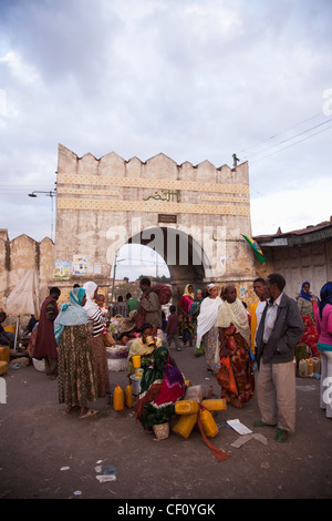 Africa, Ethiopia, Harar, People lingering and trading outside Asmadin Ber gate - Stock Photo