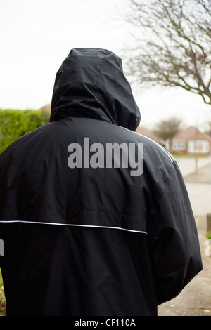 Undesirable character rogue hoodie acting suspiciously MODEL RELEASED - Stock Photo