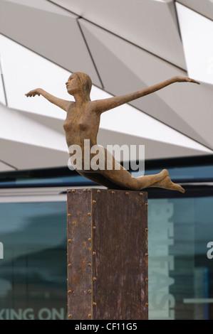 Bronze statue outside the Titanic Signature Building - Stock Photo