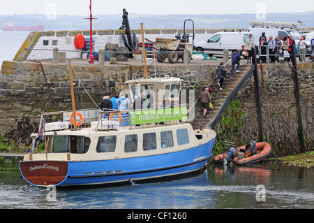Passengers leaving the Ferry 'The Duchess of Cornwall' at St. Mawes. - Stock Photo