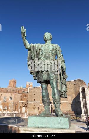 Bronze statue of the Roman emperor Nerva in via dei fori imperiali in Rome, Italy - Stock Photo