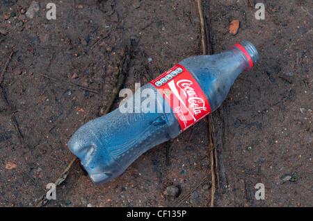 Plastic Coca Cola bottle litter - Stock Photo