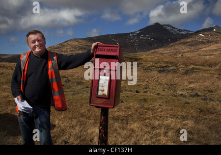 Alastair, Isle Of Mull Postie (postman), western Scotland UK , emptying red post box - Stock Photo