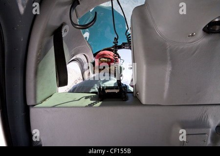 Detail of interior mountain helicopter and pilot landing on peak of Mount Cook the highest mountain in New Zealand. - Stock Photo