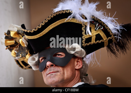 A portrait of man in Carnival costume and feathered hat, Venice, Veneto, Italy - Stock Photo