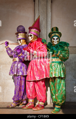 Three women dressed up for the Carnival in Venice, Veneto, Italy - Stock Photo