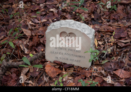gravestone marking the burial of family pets North Florida - Stock Photo