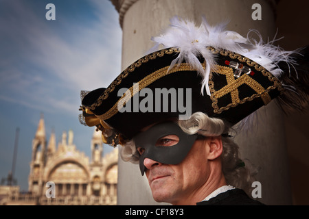 A man in Carnival costume looking upon St. Marcus Square, Venice, Veneto, Italy - Stock Photo
