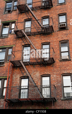 Apartment Building Fire Escape Ladder fire escape on side of apartment building stock photo, royalty