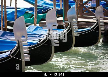 Prows of gondolas moored by Saint Mark square - Venice, Venezia, Italy, Europe
