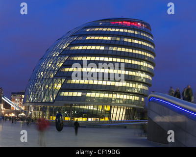 London City Hall illuminated with lights on in the early evening twilight viewed from the Queen's Silver Jubilee - Stock Photo
