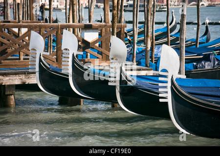 Prows of gondolas moored by Saint Mark's square - Venice, Venezia, Italy, Europe