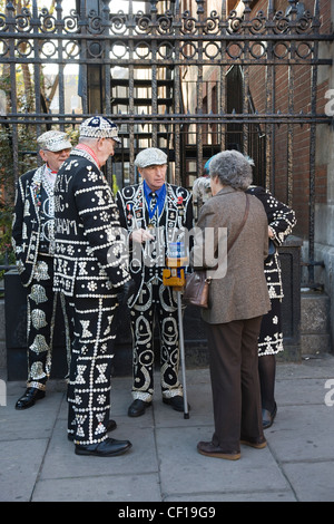 Pearly Kings and Queens collecting money for charity in Covent Garden, London - Stock Photo