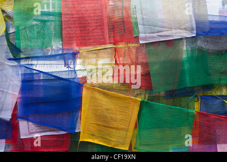 Flags with prayers at Swayambhunath Stupa (Monkey Temple) in Kathmandu, Nepal. - Stock Photo