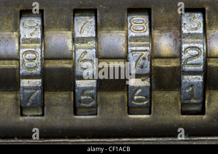macro image of brass combination lock with the number set to 8672 - Stock Photo