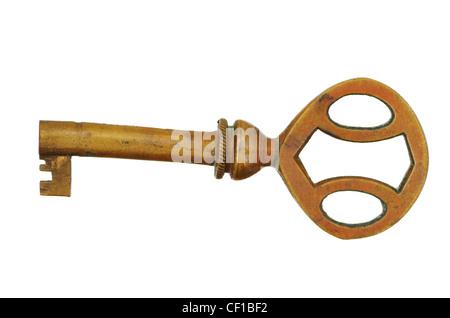 old antique brass key isolated on white background - Stock Photo