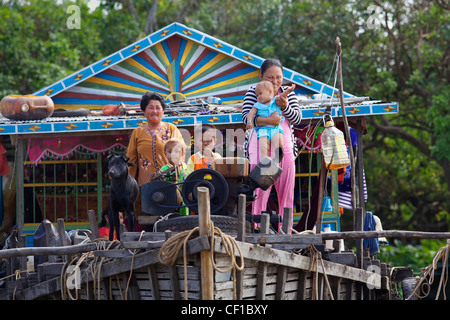 Cambodian family on their floating home on Tonle Sap Lake in Siem Reap, Cambodia - Stock Photo
