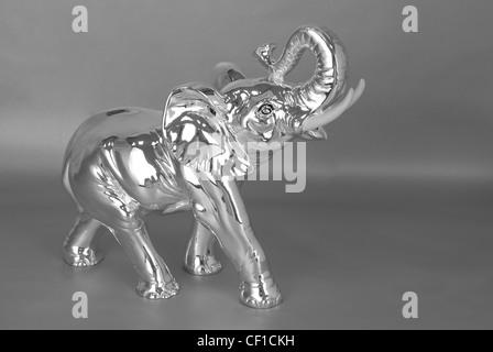 Silver jewelry elephant on a grey - Stock Photo