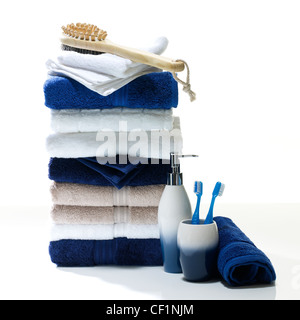 A still life shot of a stack of bathroom towels and accessories - Stock Photo