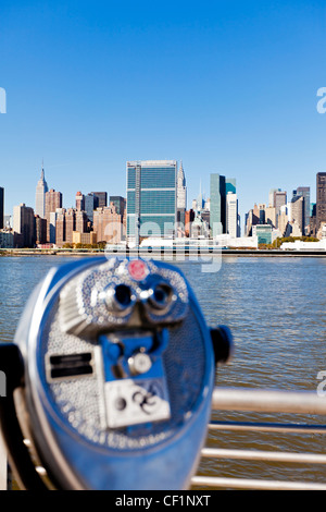 Skyline of Midtown Manhattan seen from the East River, New York, United States of America - Stock Photo