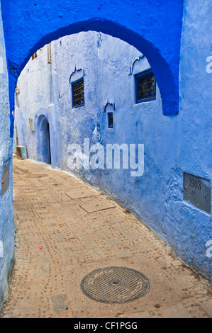 Street in blue walled old medina of Chefchaouen, Morocco - Stock Photo